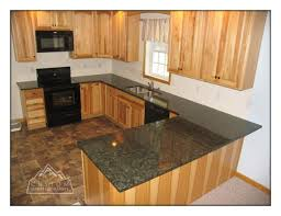 hickory cabinets with granite countertops granite kitchen countertops and cabinets verde peacock granite on