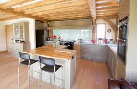 l shaped kitchen island rustic traditional kitchen and eposed wood ceiling beams also small