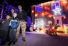 hampshire father covers his house in christmas lights to raise