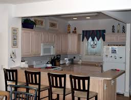 u shaped galley kitchen with varnished oak wood top kitchen island