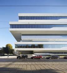 zaha hadid designs commercial office structure clad in alucobond plus