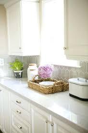 quartz tile backsplash decorating dark kitchen cabinets with