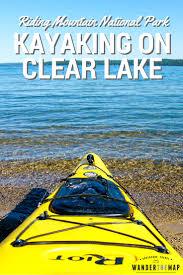 kayaking on clear lake in riding mountain national park wander