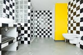 modern bathroom with checkered black and white tiles on walls