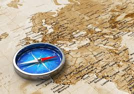 world map stock image blue metal compass on the world map stock photo scanrail