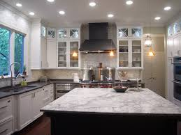 white kitchen island with black granite top white granite on the island and a compliment of grey