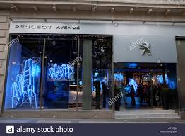 peugeot showroom peugeot store champs elysees paris france stock photo royalty