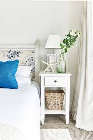blue french floral headboard with white french nightstand