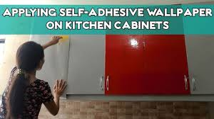 what glue to use on kitchen cabinets applying glossy self adhesive wallpaper on kitchen cabinets