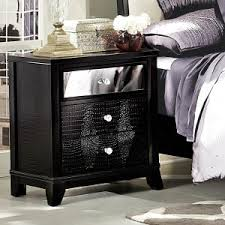furniture black nightstand with lighting lamp and brown wall