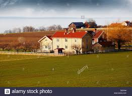old farm houses and cottages in rural sweden stock photo royalty