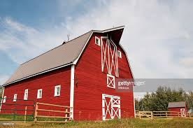 large red and white barn with a hay loft stock photo getty images