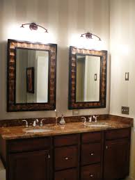 gold framed wall mirror wall mounted lamps white granite washstand