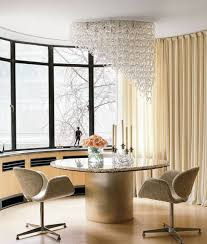 contemporary dining room with ceiling lighting over round dining