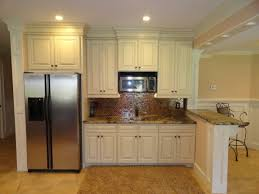 Wet Kitchen Cabinet Kitchen Mediterranean Kitchen Design In Basement With White