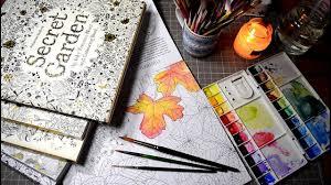 testing watercolors in coloring books secret garden magical
