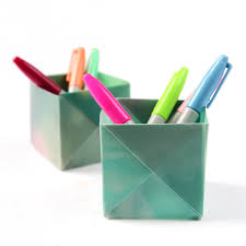 dress your desk in style with these origami pen holders