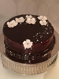 sponge cake covered by a chocolate mirror glaze i was so