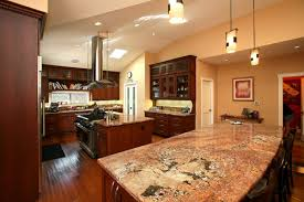 kitchens with black appliances and oak cabinets i have medium oak cabinets honey color and terracotta floor and
