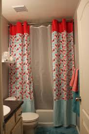 small fun kids bathroom with double red blue fabric shower curtain