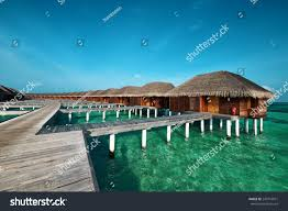 beautiful beach water bungalows maldives stock photo 249716971