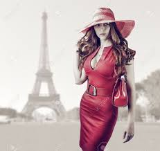young beautiful woman wearing red dress hand bag belt
