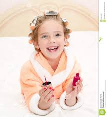 happy funny little polishing her nails stock photo image
