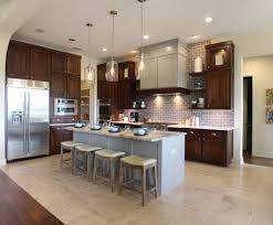 soapstone countertops dark brown kitchen cabinets lighting