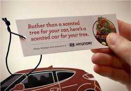 car shaped tree ornament with new car smell the big ad