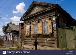 beautiful old wooden houses with shutters irather worn buildings