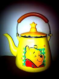 the new adventures of winnie t vintage winnie the pooh disney tea pot yellow orange red with star