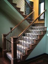 dark treads with white risers metal spindles square wood posts