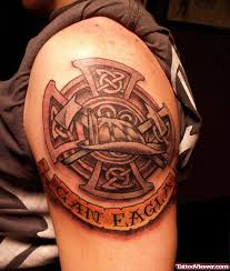 grey ink celtic cross firefighter tattoo on left shoulder tattoo