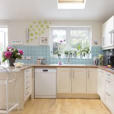 kitchen blue tile backsplash cream cabinet and drawer marble