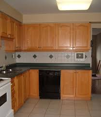 Kitchen Cabinets Oak Kitchen Oak Restaining Cabinets With Daltile Backsplash And Black