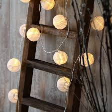 transition fun summer string lights into fall friendly decor by