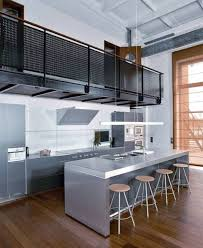 gorgeous modern industrial kitchen design with dining table and