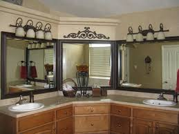 frame those triple mirrors and hide the unsightly seam bathroom