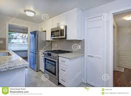 white shaker kitchen cabinets to ceiling photo of a small compact kitchen with white shaker cabinets