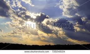 sun breaks through the clouds stock images royalty free images