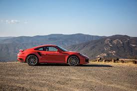 orange porsche 911 turbo porsche 911 turbo s nearly as fast as 918 spyder around big willow