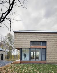 bourgeois lechasseur wraps canadian house in the woods with