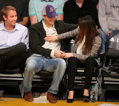 mila kunis ashton kutcher seen with possible engagement ring at