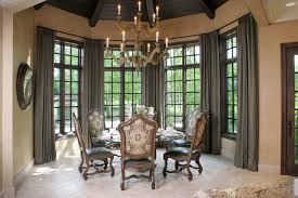 tuscan dining room with walnut beamed ceiling and weathered