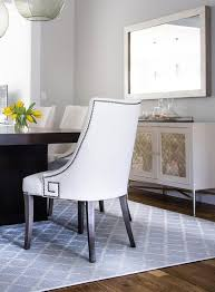 espresso stained dining table with white greek key dining chairs