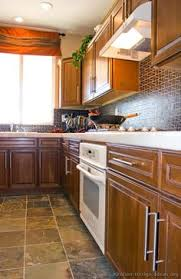 Medium Brown Kitchen Cabinets by Traditional Medium Wood Cherry Kitchen Cabinets With Black