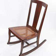 Cane Rocking Chair Vintage Cane Rocking Chair And Framed Color Etching Ebth