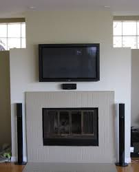round grey mantel electric fireplace on grey wall connected by