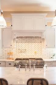how to apply backsplash in kitchen glazed brick backsplash with herringbone pattern pot filler niche