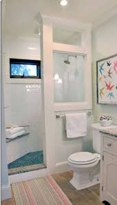 small bathroom with wall mounted vanity sink toilet narrow